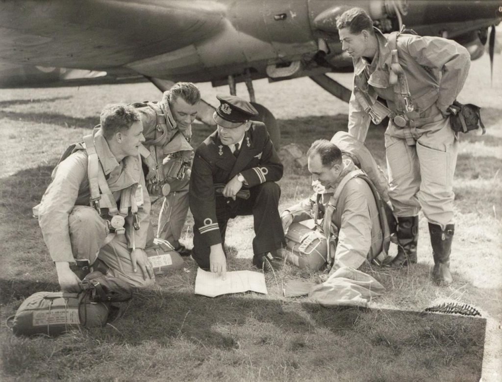 WW2 airmen planning their next mission